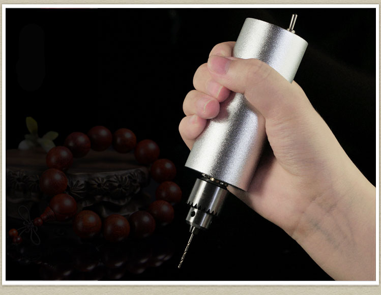 Small drill ,Jade, Man playing electric grinding, drilling, grinding, polishing, cutting, carving